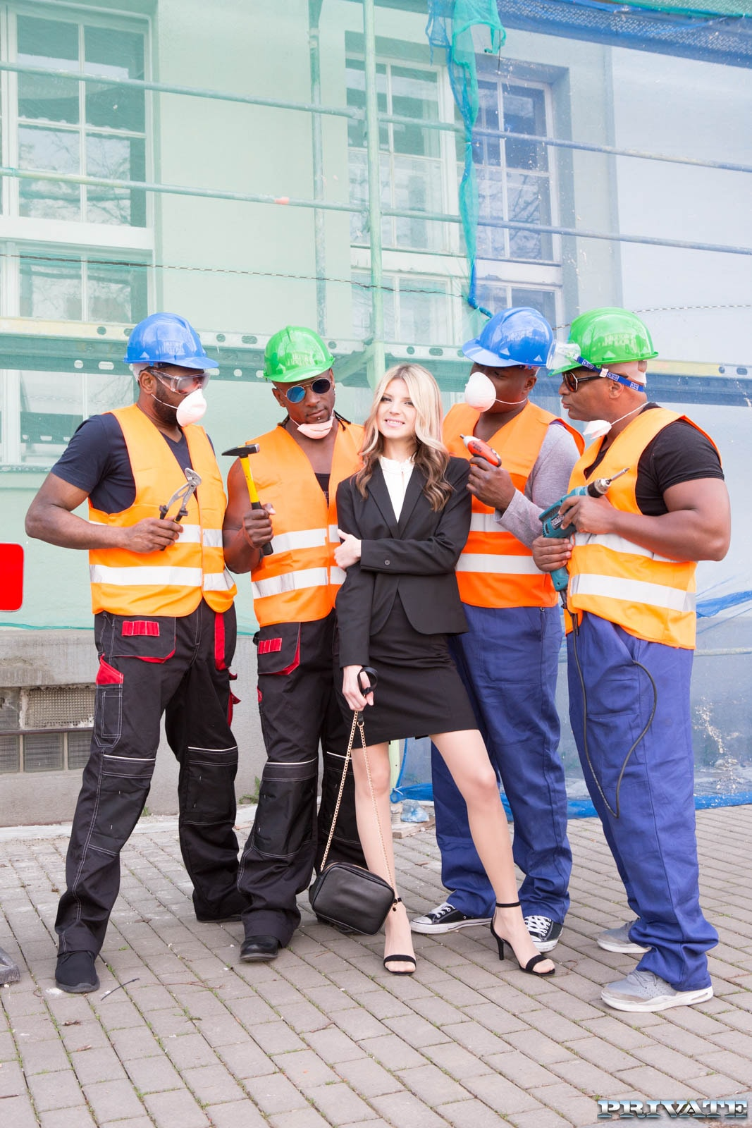 Gina Gerson with black male labourers