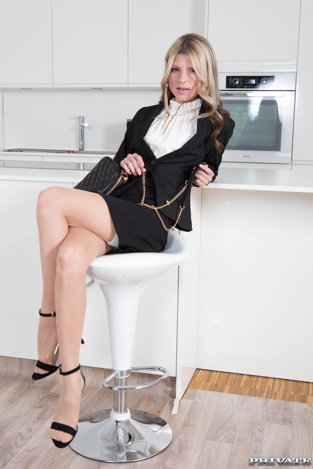 Gina Gerson in black business suit