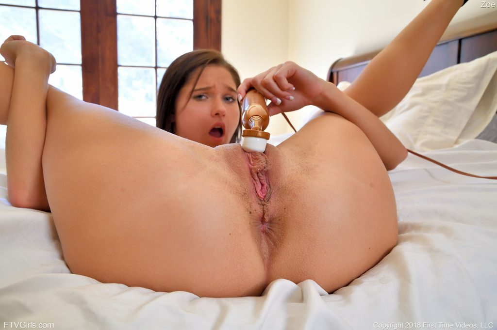 girl using vibrator on her pussy