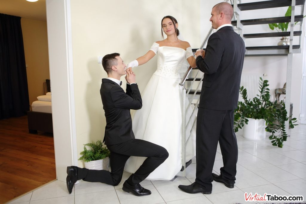 beautiful bride with groom and his father