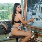 teen Latina Gabriela Nova painting in her studio