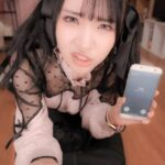 angry Japanese girl holding smartphone