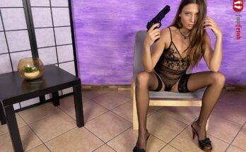 foot fetish model Talia Mint in lingerie pointing pistol at her head