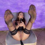 Talia Mint with sexy feet in air pointing gun